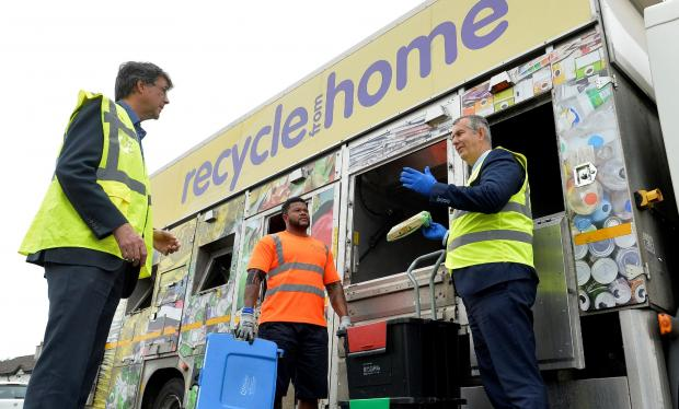 Minister Edwin Poots met Bryson Recycling's Director Eric Randall and employee Philip Margaret, from a local collection team in Ballyclare, to see a kerbside box collection.