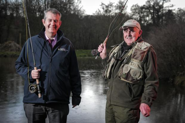 Minister Poots pictured with angler Joe Stitt at Shaws Bridge Belfast